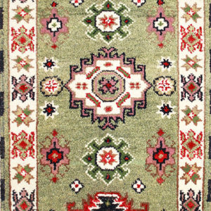 green Kazak hand-knotted rug