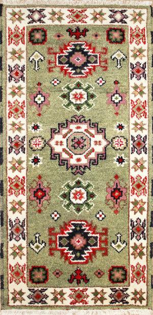 green Kazak hand-knotted rug