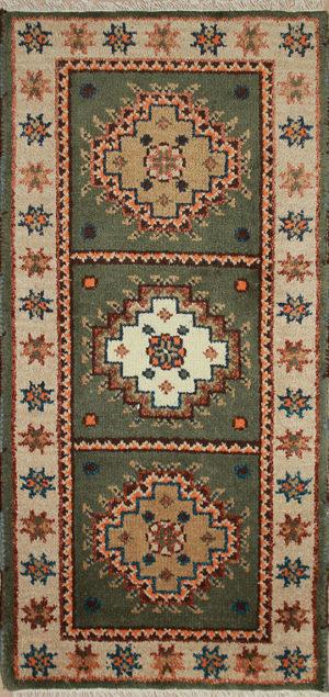 Green Kazak area rug