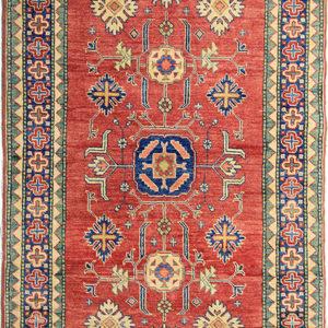 Red oriental Kazak rug